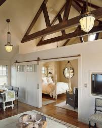 25 Bedrooms That Showcase The Beauty Of Sliding Barn Doors Beautiful Built In Ertainment Center With Barn Doors To Hide Best 25 White Ideas On Pinterest Barn Wood Signs Barnwood Interior 20 Home Offices With Sliding Doors For Closets Exterior Door Hdware Screen Diy Learn How Make Your Own Sliding All I Did Was Buy A Double Closet Tables Door Old