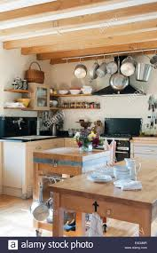 100 Rustic Ceiling Beams Pots And Pans Hang From A Rack In A Rustic Kitchen With