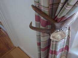 Antler Curtain Tie Backs by Curtain Rod Finial And Tiebacks Made From Antlers Popsugar Home