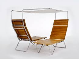 specializes in teak wood outdoor furniture