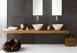 modern minimalist bathroom with wall mounted sink faucet and twin