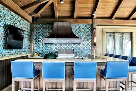 mediterranean style outdoor kitchen with blue moroccan tile