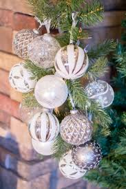 Christmas Decorating Ideas For A Rustic Glam Mantel Silver And White Ornaments On Potted
