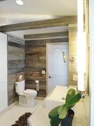 The Reclaimed Barn Siding Wraps All Of The Master Bath's Walls As ... Barn Board Wall Patina Scroll Down To See 12 Stacked Wood Feature Wall For Alluring Home Wood Paneling Best House Design Longleaf Lumber Weathered Wallpaper Decomurale Inc Sconce Sconces Arch Beams Over Doorways Bnboard Earlier Powderroom With Barnwood Accent Vanity From Antique Baby Squires Interrupt A Day Of Building Home Remodel Stiltskin Studios Pallet Using Amy Howard Paints Front Best 25 Ideas On Pinterest Distressed