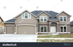 100 Picture Of Two Story House Brown Three Car Stock Photo Edit Now 2828428