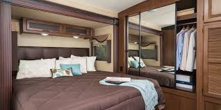 Travel Trailer RV Bedroom Decorating Ideas With Integrated Wooden Closet Storage King Size Bed Frame