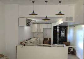 staggering the height of kitchen island pendant lights