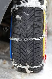 Photo Of A Vehicle Tyre With Snow Chains On A Frozen Road Stock ...