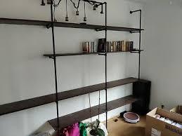 grosses wasserrohr industriedesign wohnzimmer regal loft