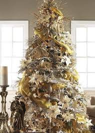 Combinations Of Gold Silver And Cream Tree Is Swathed In Crinkle Tissue Fabric Colored Poinsettias Stars Ball Sprays Picks