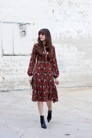 a fall floral midi dress jeans and a teacup