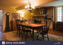 Dining Room Of An Early 18th Century Home, Quebec, Canada Stock ... Windsor Ding Chair Fly By Night Northampton Ma Antique Early American Carved Wood With Sabre Legs Desk Side Accent Vanity 76 Astonishing Gallery Of Maple Chairs Best Solid Mahogany Shield Back Set Handmade Shaker Farm Table 72 By David S Edgerly Customer Fniture Edna Winchester Countryside Amish 19c Cherry Extendable Rockwell How To Choose For Your Custom Ochre Forcloth Forcloths Custmadecom Country Farmhouse Room Amazoncom Hardwood Xback Of 2