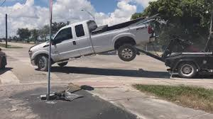 Man Tries To Drive Away As His Repossessed Pickup Truck Is Towed
