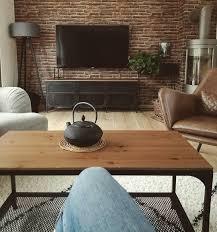 wohnzimmerliebe wohnzimmer steinwand kamin tvb