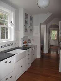 Clean Lines In A 1930s Colonial Revival Brackets Under Cabinets Tile Up Wall