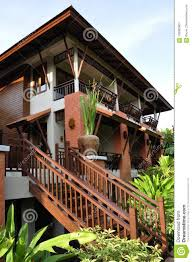 100 Thai Modern House Style Set Amid Magnificent Vegetation Stock Image