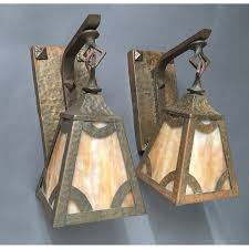 brass hammered arts crafts wall sconce pair with caramel slag
