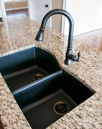 Who Makes Luxart Sinks by Black Granite Composite Sink With Kohler Oil Rubbed Bronze Faucet