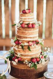 A Naked Wedding Cake With Strawberries