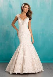V neck mermaid wedding dress with beaded cap sleeves and tiered lace