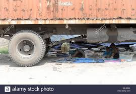 Truck Driver And Helper Take Rest Under A Truck During Hot Day In ...