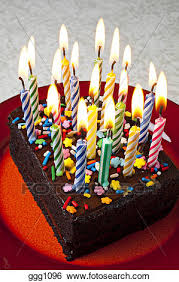 Stock Image Chocolate birthday cake with candles fire flame frosting dessert