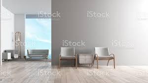 modernes interieur wohnzimmer holzboden mit sitzgarnitur gefundenes fressen stuhl vor wohnzimmer blick auf das meer sommer 3drendering stockfoto und