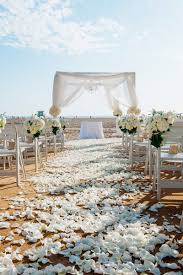 Beachside Wedding Ceremony With White Petals On Aisle Bundles Of Hydrangeas Roses