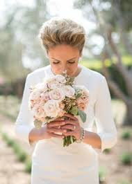 Bride In Three Quarter Sleeve Wedding Dress Smells Rose Bouquet