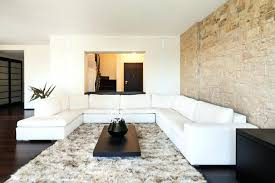 Stone Wall In House The Luminous Limestone Accent Contrasts With Espresso Plank Flooring