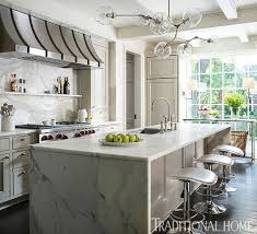Paloma Contreras Via Traditional Home A Waterfall Edge Marble Counter With Matching Backsplash
