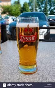 100 Poland Glass Of Polish Tyskie Beer Europe Stock Photo