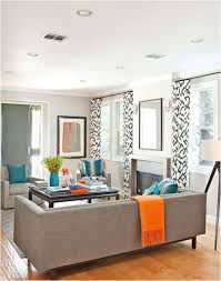 New Look For The Den Since Were Painting It Grey Love Orange And Teal Accents