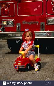 Two Year Old Boy Wearing Fire Hat And Riding Toy Fire Truck In Front ... Fire Truck Electric Toy Car Yellow Kids Ride On Cars In 22 On Trucks For Your Little Hero Notes Traditional Wooden Fire Engine Ride Truck Children And Toddlers Eurotrike Tandem Trike Sales Schylling Metal Speedster Rideon Welcome To Characteronlinecouk Fireman Sam Toys Vehicle Pedal Classic Style Outdoor Firetruck Engine Steel St Albans Hertfordshire Gumtree Thomas Playtime Driving Power Wheel Truck Toys With Dodge Ram 3500 Detachable Water Gun