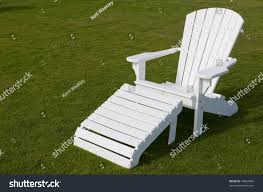 White Adirondack Lounge Chair Green Grass Stock Photo (Edit Now ... Modern Rocking Resin Adirondack Chair Loll Designs Cushions Lowes Fresh Pool Lounge Chairs At Amazoncom Polywood Adirondack Chair With Retractable Ottoman Cedar Dfohome Chaise Adjustable Back Outdoor Style Log Made In Usa Reclaimed Wood Save The Planet Fniture Simple Wooden Old Envirobuild Deck Recline Able Pullout