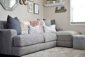 Raymour And Flanigan Grey Sectional Sofa by Our Living Room Tour By Erika Batista