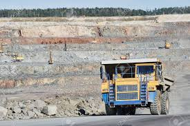 Huge Dump Truck Transporting Granite Rock Or Iron Ore Fotos ... Heavy Excavator Loading Granite Rock Or Iron Ore Into The Huge Watch This Giant Dump Truck Fart Out An Actual Fireball Mine Worker Truck Driver Dwarfed By Huge Ming Dump In American Plastic Toys Gigantic Walmartcom Big Stock Photo Image Of Outdoors Black 62349404 Man Front Wheel Uranium Mine Wheel Loader Sizzlin Cool Beach Color And Styles May Vary At Ok Tedi Gold Papua New Guinea Stock Photo Xxl Rc Cstruction Site Big Scale Model Dump Trucks And Excavator Just A Picture Huge I Mean Just Look It 4k 450 Tone Video Footage Videoblocks