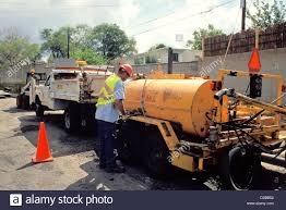 New Mexico. Santa Fe. Lopez Street Road Repair. Truck And Worker At ...