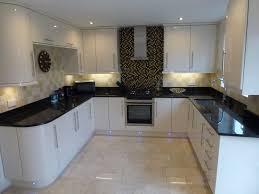 kitchen cabinets european style where should backsplash end black