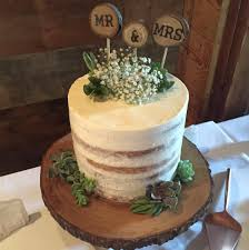 Rustic Naked Cake With Succulents On A Wooden Stand