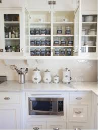 Inspiration For A Timeless Kitchen Remodel In San Diego With Glass Front Cabinets White