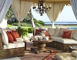 outdoor patio with woven sectional seating and coffee table