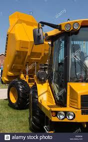 100 Blue Dump Truck Under Deep Blue Sky A Clean Bright Yellow Hydrema 922D Dump Truck