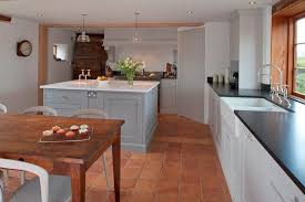 tile floor with mediterranean style kitchen kitchen