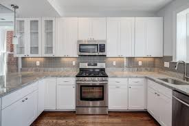 Antique White Kitchen Design Ideas by Smoke Glass Subway Tile Grey Backsplash White Cabinets And