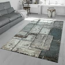 wohnzimmer teppich grau steinboden optik karo muster fliesen