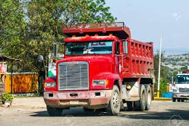 100 Red Dump Truck GUERRERO MEXICO MAY 27 2017 Freightliner Stock