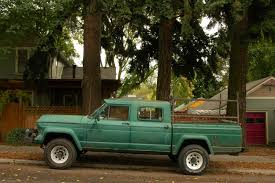 Old Parked Cars.: 1965 Willys Jeep Gladiator J300