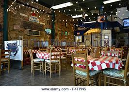 A Retro And Cool Old Historic Rustic Brick Seafood Restaurant With Menus On The Wall