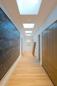 this hallway is filled with skylights to add light home